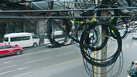 BANGKOK. THAILAND - CIRCA FEB 2015: Messy. spaghetti-like coils of telephone and Footage