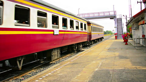 BANG PA-IN. THAILAND - CIRCA NOV 2013: Crowded passenger train cruises through t Footage