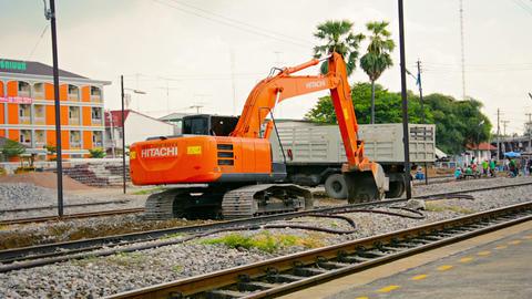 LOPBURI. THAILAND - CIRCA NOV 2013: Hydraulic excavator working on the rail bed Footage