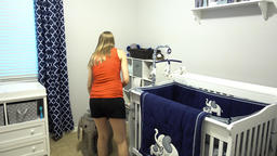 Young Pregnant Woman Prepares Her New Nursery Footage