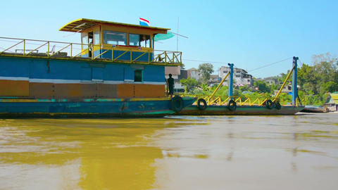 HUAY HAI. LAOS - CIRCA DEC 2013: Timelapse shot of barge and boat traffic along Footage