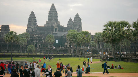 ANGKOR. CAMBODIA - CIRCA DEC 2013: Tourists visitng Angkor Wat temple. a world h Footage