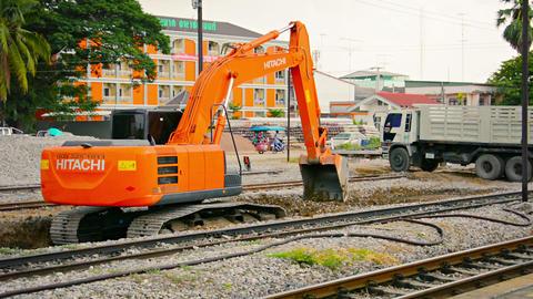 LOPBURI. THAILAND - CIRCA NOV 2013: Hydraulic excavator raking and levelling gra Footage