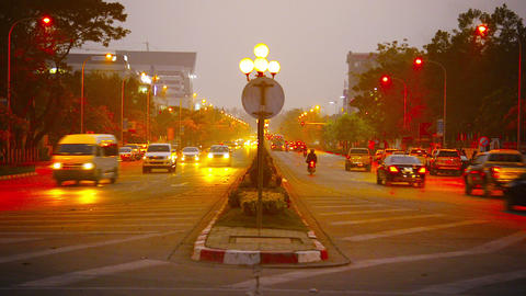 VIENTIANE. LAOS - CIRCA DEC 2013: Moderate traffic along a beautifully illuminat Footage