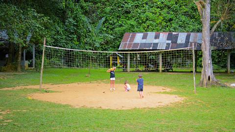 VANG VIENG. LAOS - CIRCA DEC 2013: Children playing at boules at a tourist resor Footage