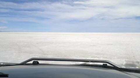 Off-road vehicle driving on Salar de Uyuni, Bolivia Live Action