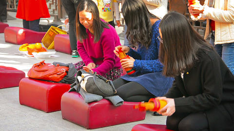 HONG KONG. CHINA - CIRCA JAN 2015: Buddhist women kneel on cushions and pray at Footage