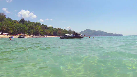 PHUKET. THAILAND - CIRCA FEB 2015: Unmanned personal water craft bobs and drifts Footage