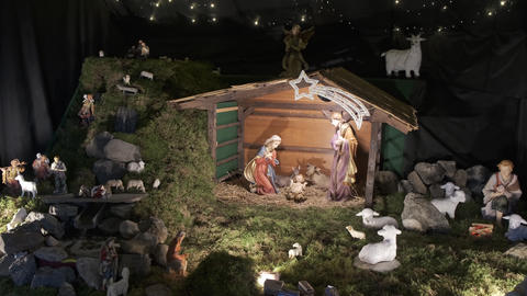 Traditional Christmas nativity scene, Holy family with baby Jesus in crib Live Action