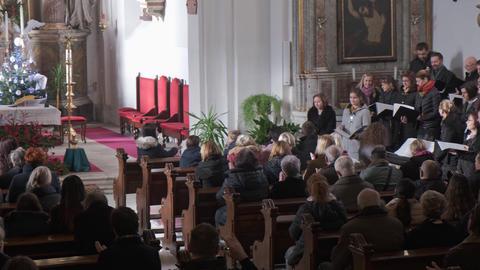 Church choir sings Christmas carols during service in Catholic church Live Action
