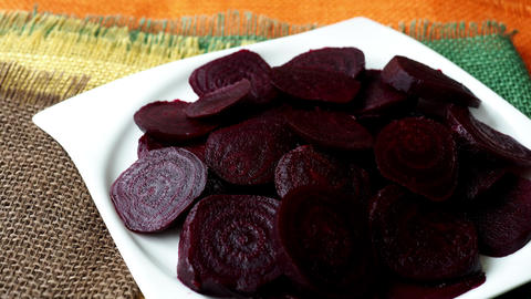 Beetroot (beet) chopped for salad in plate. Healthy ingredient for cooking. Cooked beet Live Action