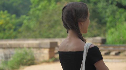 slim girl walks to railway road among nature slow motion Live Action