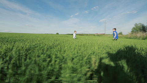 Brothers Running Through A Green Field Live Action