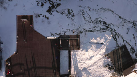 Tourist people swinging over mountain edge in winter resort top view. Aerial top shooting from Live Action