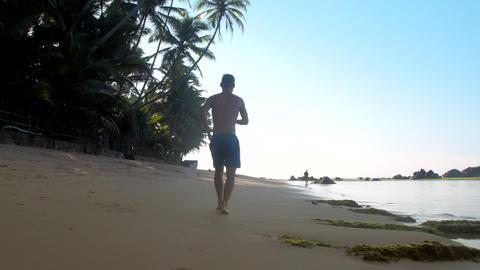 people run along pictorial ocean coastline slow motion Live Action