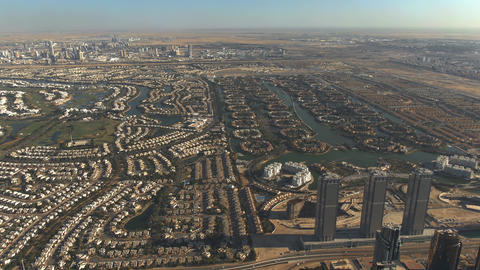 Aerial shot of luxury Emirates Hills and Jumeirah Islands communities in Dubai Live Action