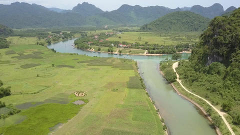 tranquil river runs along valley with fields aerial view Live Action