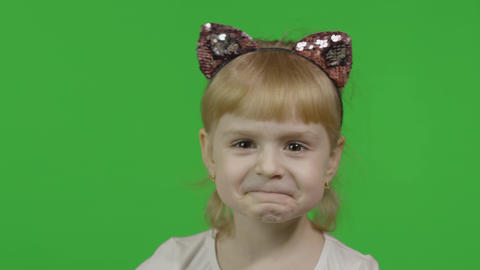Girl in headband with a cat ears shows emotion of dissatisfied. Chroma Key Live Action