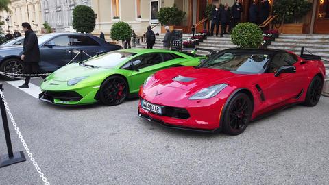 Red Corvette Grand Sport And Green Lamborghini Aventador SVJ GIF