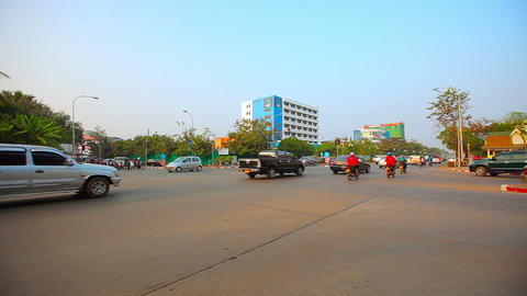 Typical morning traffic at a central intersection in Vientiane. Laos. on a clear Footage