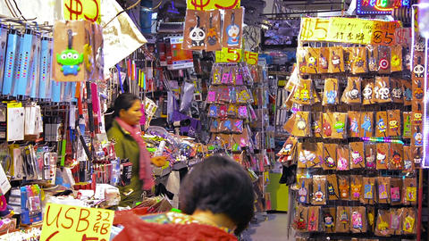 Shoppers browse the wares of a local craft supply shop in a local public market Footage