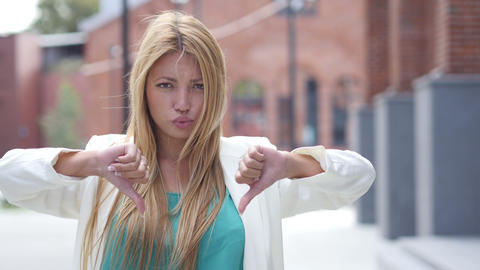 Thumbs Down for Failure by Beautiful Blonde Girl, Outdoor Portrait Footage