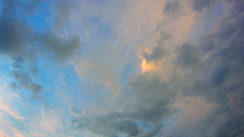 Puffy Clouds Drifting across the Sky in the Fading Light Footage