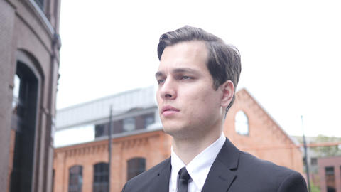 Walking Serious Young Businessman to Office Footage