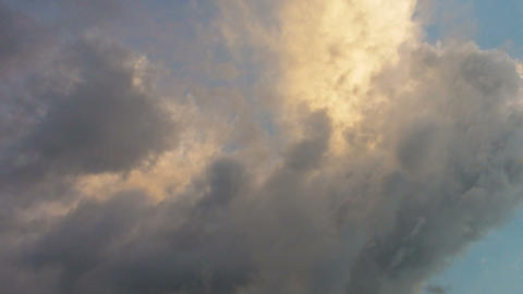 Fluffy Clouds Drifting across the Sky in the Fading Light Footage
