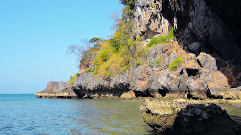 Crumbling Cliff Face along a Tropical Coastline Footage