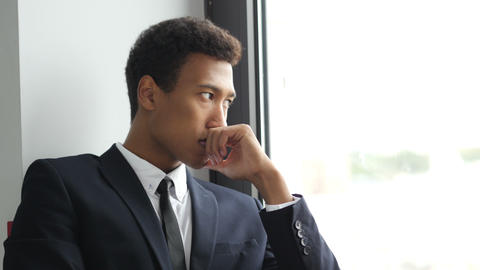 Thinking Pensive Black Businessman in Suit, Looking Through Window Footage