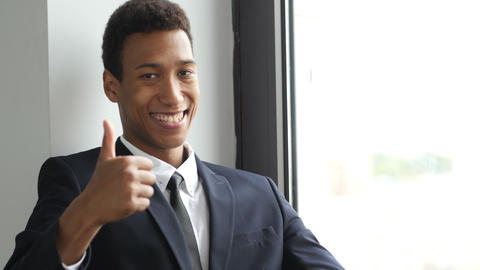 Thumbs Up by Black Man in Suit Live Action