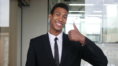 Thumbs Up by Black Businessman in Office Live Action