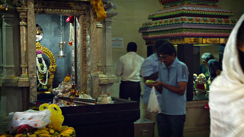 Hindu priests and worshippers inside a temple in the Indian district of Singapor Footage