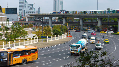 Typical urban traffic on a roundabout in downtown Bangkok. with a victory war me Footage