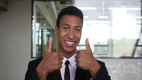 Thumbs Up by Black Businessman in Suit in Office Live Action