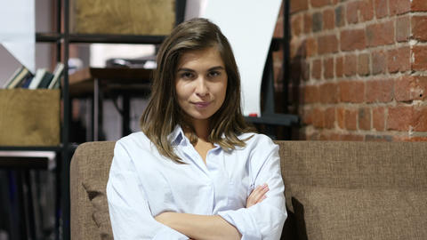 Frustrated Upset Girl Sitting on Sofa in Loft Office Footage