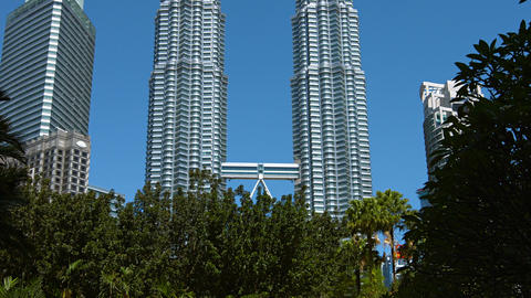 Upward tilting shot of the famous Petronas Twin Towers. reaching up into the cle Footage