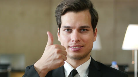 Thumbs Up by Businessman, Portrait in Office Live Action