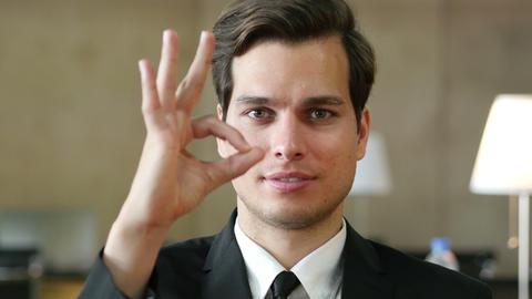 Okay Gesture by Satisfied Successful Businessman in Office Footage