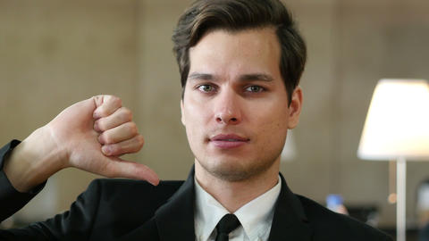 Thumbs Down by Businessman, Portrait in Office Live Action