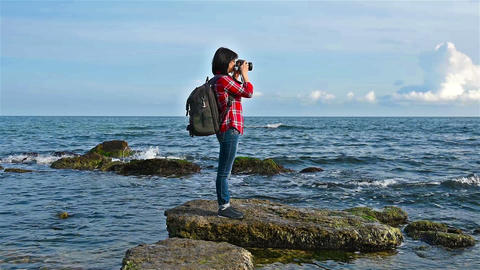 hipster girl photographing sea Footage