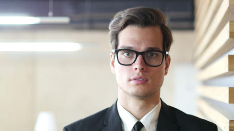 Young Businessman Portrait, Looking at Camera Footage