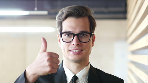 Thumb up by Businessman, Portrait Live Action
