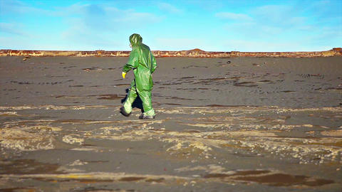 Man Crosses Toxic Waste Site in Chemical Protective Gear Footage