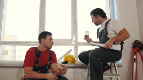 Apartment repair - draft apartment - men workers sitting on the windowsill and Live Action