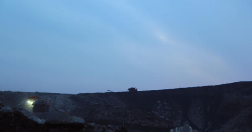 Timelapse in the evening silhouette of dump trucks transported coal Live Action