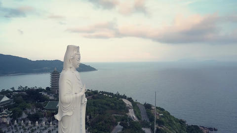 pictorial round motion buddha statue in religious complex Live Action