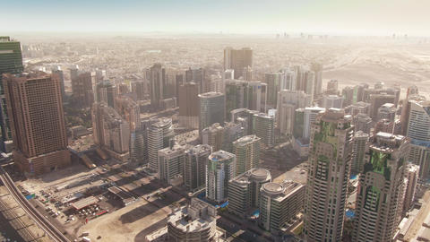 Aerial shot of skyscrapers of Barsha Heights community in Dubai, UAE Live Action