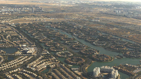 Aerial view of luxury Jumeirah Islands community in Dubai, UAE Live Action